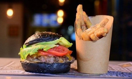 Islamabad's Street Burger serves beef patties in a black bun. Would you try it?