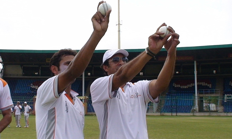 Wasim Akram passes on a few valuable tips to pace hopeful Mohammad Talha at fast bowling camp in Karachi.