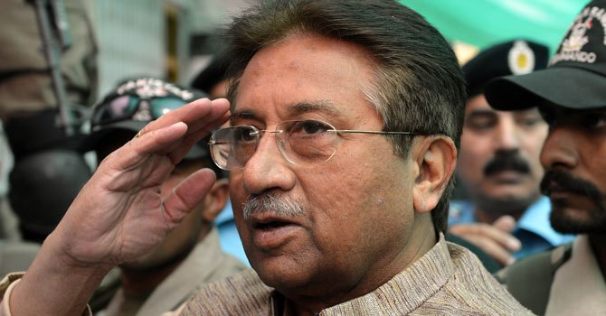 Former president Pervez Musharraf salutes on his arrival at an anti-terrorism court in Islamabad on April 20, 2013.—Photo by AFP