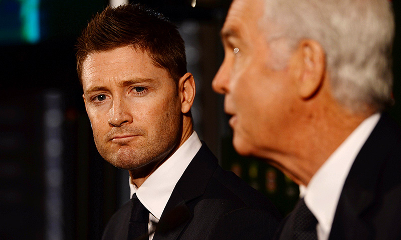 Australian Test cricket captain Michael Clarke (L) and national selector John Inverarity (R), announce the Australian squad for the upcoming Ashes. -Photo by AFP