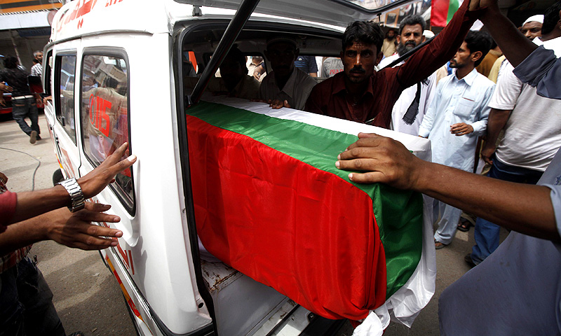 Relatives load the coffin of a bomb blast victim, draped with the flag of the Muttahida Qaumi Movement (MQM), onto an ambulance after funeral prayers in Karachi April 24, 2013. -Photo by Reuters