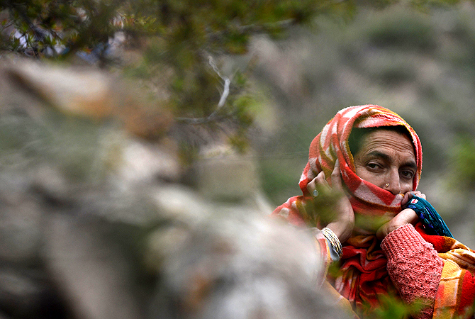 A Kashmiri muslim woman prays during the annual Aishmuqaam festival at the shrine of Sufi saint Zain-ud-din Wali in Aishmuqaam, some 75 kms (47 miles) south of Srinagar, on April 24, 2013. The farming community in Kashmir celebrates the 'festival of lights', carrying torches and offering prayers, marking the end of winter and the beginning of the agricultural season.  — AFP Photo