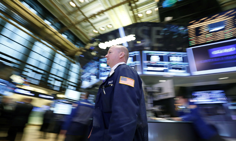 Traders work on the floor at the New York Stock Exchange, April 23, 2013. — Reuters Photo