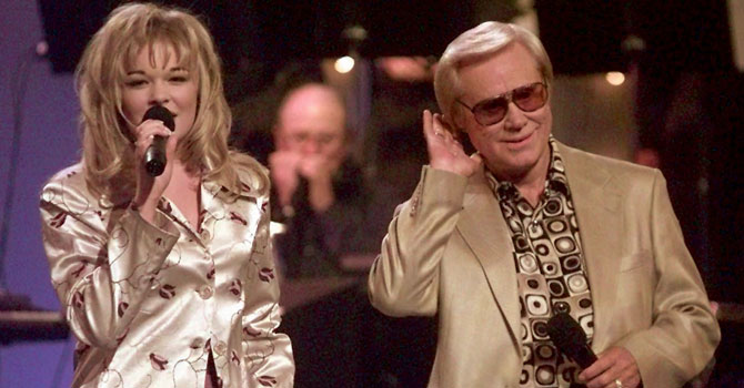 In this 1997 file photo, Country music veteran George Jones performs with 14-year-old newcomer LeAnn Rimes during the opening segment of the TNN-Music City News Country Awards show. —Photo (File) AP