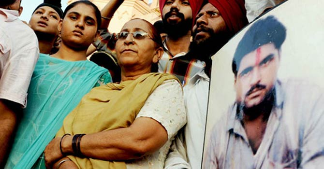This picture shows relatives of jailed Indian inmate Sarabjit Singh.—File Photo