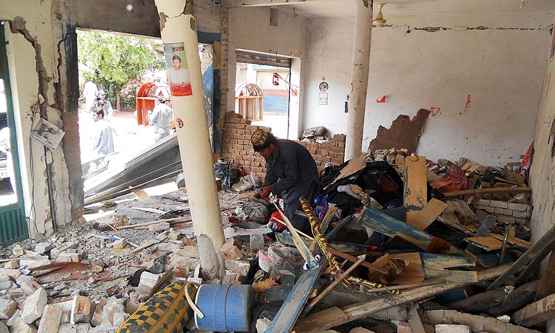 A destroyed office of an election candidate following a bomb attack in the city of Kohat, adjacent to Pakistan's tribal areas along the Afghan border on April 28, 2013. — Photo by AFP