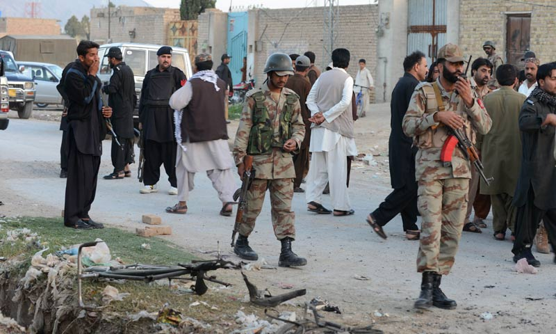 Security personnel gather at the site of a bomb explosion in Quetta. -AFP Photo