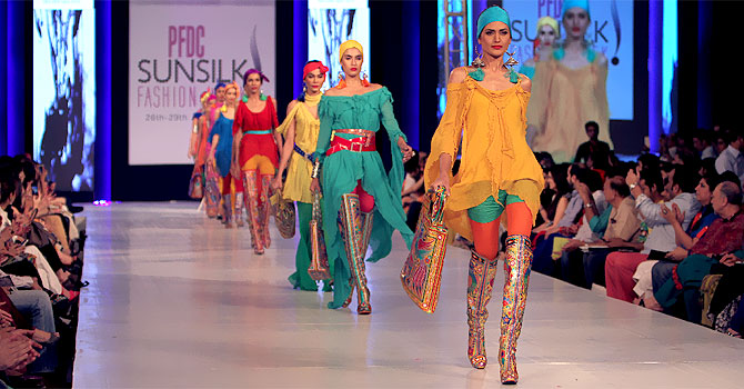 Designer: Rizwan Beyg, dozens of designers, brands and textile houses are presenting their collections during the four-day Lahore Fashion Week sponsored by the Pakistan Fashion Design Council.–Photo by AP