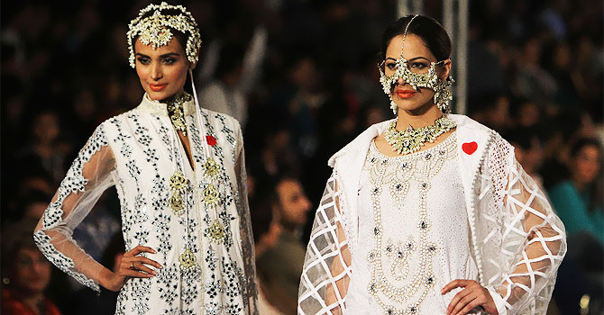 Models present creation of a designer Ali Xeeshan during Lahore Fashion Week.–Photo by AP