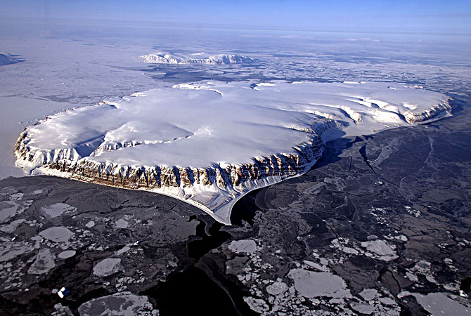 Nasa handout image shows Saunders Island and Wolstenholme Fjord with Kap Atholl in the background seen during an IceBridge survey flight near Qaasuitsup, Greenland. Sea ice coverage in the fjord ranges from thicker, white ice seen in the background, to thinner grease ice and leads showing open ocean water in the foreground. — AFP Photo