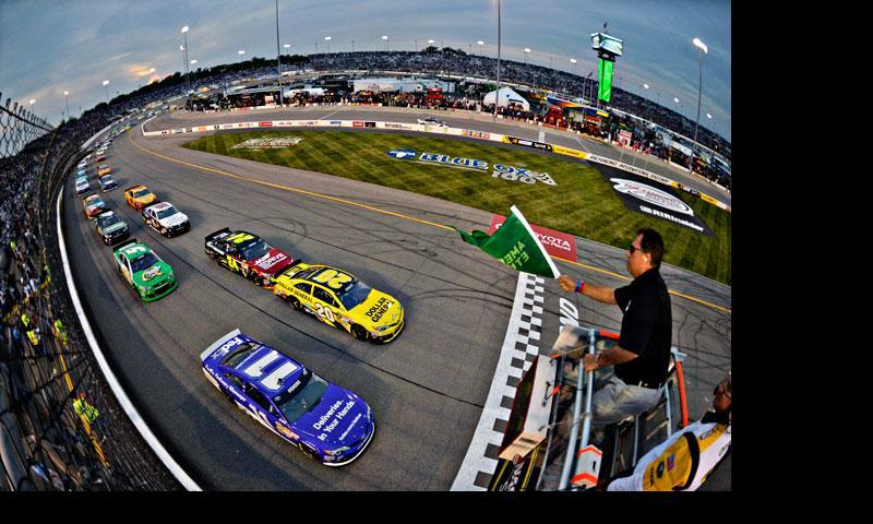 In this photo made using a fisheye lens, Matt Kenseth (20) and Brian Vickers (11) lead the field at the start the Toyota Owners 400 NASCAR Sprint Cup Series race April 27, 2013, at Richmond International Raceway in Richmond, Va. — AP Photo