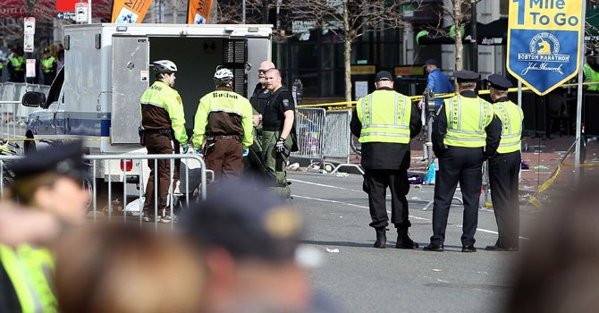 Boston Police guard an area at the one mile checkpoint near Kenmore Square after two bombs exploded during the 117th Boston Marathon on April 15, 2013 in Boston, Massachusetts.—Photo by AFP