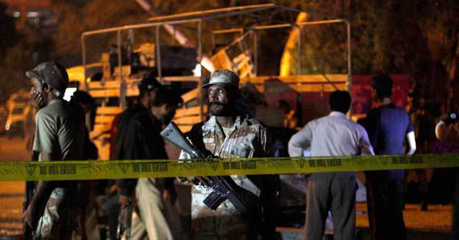 A Ranger stands guard at the site of a bomb explosion in Karachi on April 3, 2013. – Photo by Reuters