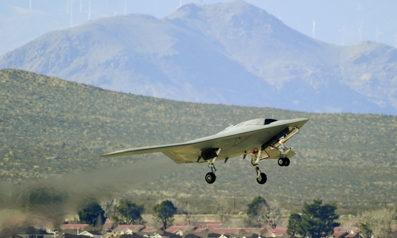 In this Feb. 4, 2011 photo released by the US Navy and Northrup Grumman, the navy X-47B Unmanned Combat Air System Demonstration aircraft successfully completes its historic first flight at Edwards Air Force Base, California. — AP Photo