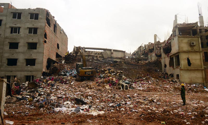 n a file picture taken on May 4, 2013, excavators clear debris as rescue and army personnel continue recovery operations at the site of the eight-storey building collapse in Savar, on the outskirts of Dhaka.— Photo AFP