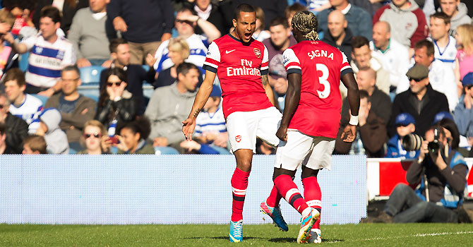 Arsenal's Theo Walcott, left celebrates after scoring a goal with teammate Bacary Sagna. -Photo by AP