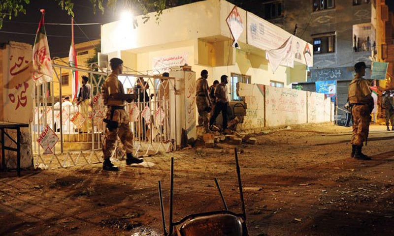Pakistani security officials cordon off the site of twin bomb blasts near the secular Muttahida Qaumi Movement (MQM) party office in Karachi on May 4, 2013.
