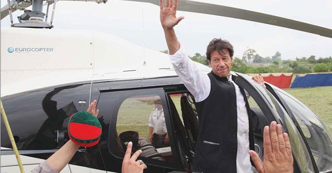 PTI chief Imran Khan pictured outside his helicopter after speaking at a poll rally. – File Photo