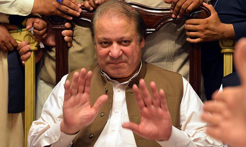 Former Pakistani premier Nawaz Sharif gestures as attends a meeting of traders during election campaign in Islamabad on May 1, 2013. — Photo by AFP