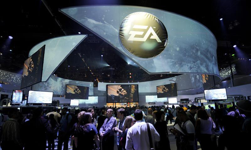 Attendees at the Electronic Entertainment Expo visit the Electronic Arts booth on the first day of E3 in Los Angeles, California June 5, 2012. — Reuters Photo