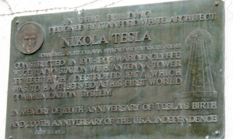 Photo shows a plaque affixed to a Shoreham, NY building that was once the laboratory of physicist/inventor Nikola Tesla. — AP File Photo
