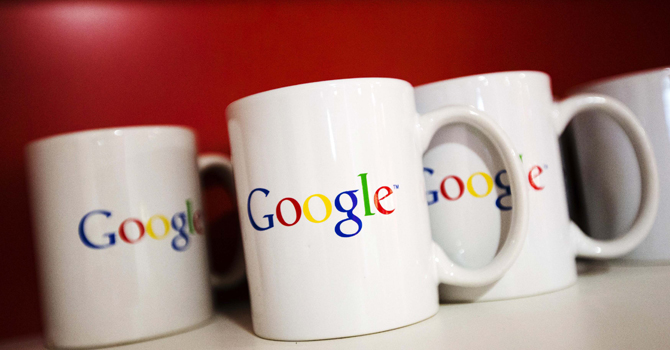 Coffee cups with Google logos are seen at the new Google office in Toronto, November 13, 2012. — Reuters Photo