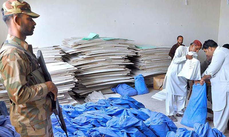 Returning office staff packing the general election relegated material during handing over to concerned authorities at Session Court under the supervision of Pakistan Army. — Photo by APP