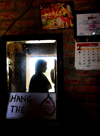 An Indian rape victim is reflected in a mirror at her home on the outskirts of Lucknow.