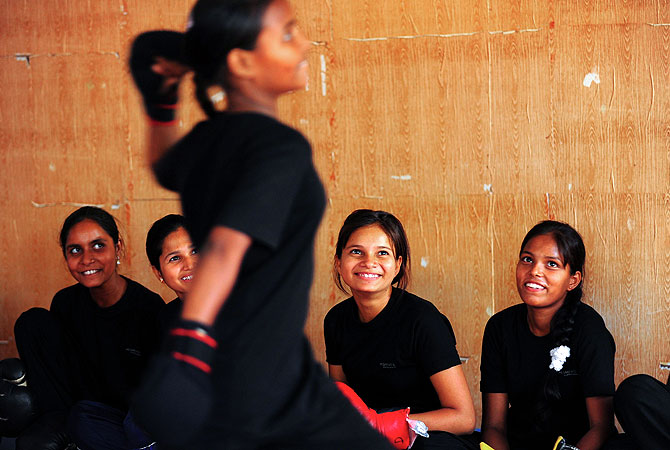 """Red Brigade"" takes part in self defense classes at a martial arts academy in Lucknow."
