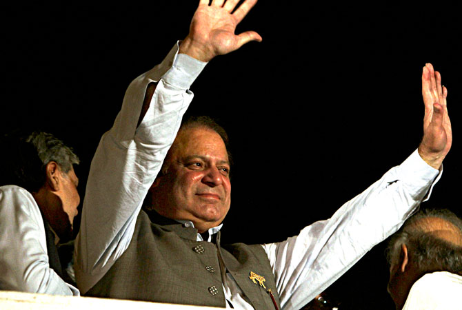 Former Prime Minister and leader of the Pakistan Muslim League-N party Nawaz Sharif waves to his supporters at a party office in Lahore, Pakistan, Saturday, May 11, 2013. — AP Photo