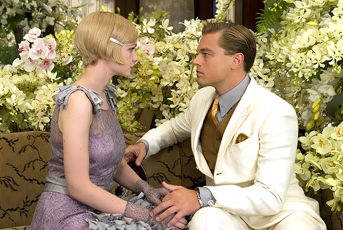 "Carey Mulligan as Daisy Buchanan, left, and Leonardo DiCaprio as Jay Gatsby in a scene from ""The Great Gatsby."" — AP Photo"