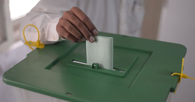 A Pakistani resident casts his ballot at a polling station during general election.–File Photo by AFP