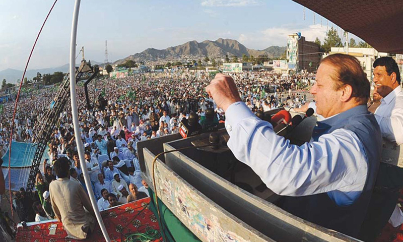 PML-N chief Nawaz Sharif addresses a public meeting in Mingora, Swat. — Dawn Photo