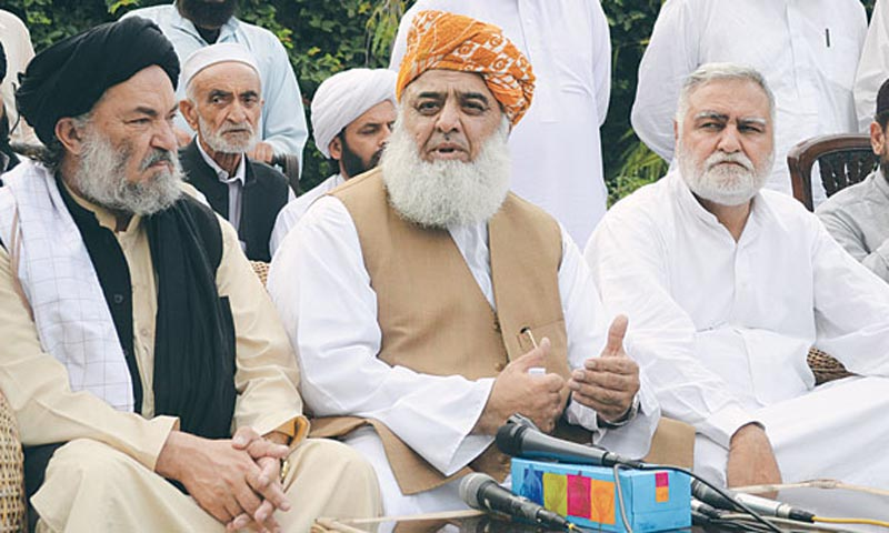 JUI-F chief Maulana Fazlur Rehman addresses a press conference here in which he rejected the victory of Pakistan Tehreek-i-Insaf in Khyber Pakhtunkhwa. — Photo by Dawn