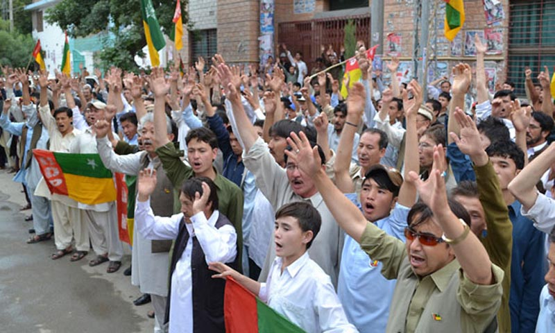 Activists of Hazara Democratic Party chant slogans during a protest demonstration in favor of their demands outside QPC. — INP Photo by Hassan Khan