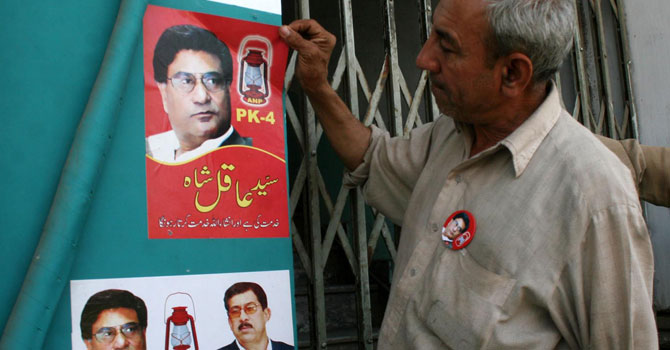 A man removing ANP stickers outside the party's election office for PK-4 due to continual attacks on his party. — Photo by INP