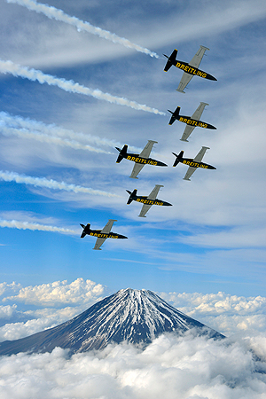 The Breitling Jet Team fly over Mount Fuji, in central Japan on Sunday, May 12, 2013. The world's only professional civilian aerobatic jet team completed their tour of Japan by visiting the Fukushima prefecture to show their support and encouragement to the people of the region still recovering from the catastrophic effects of the March, 2011, Tsunami. The team are now in transit back to Europe and will return to Asia in August. — AP Photo