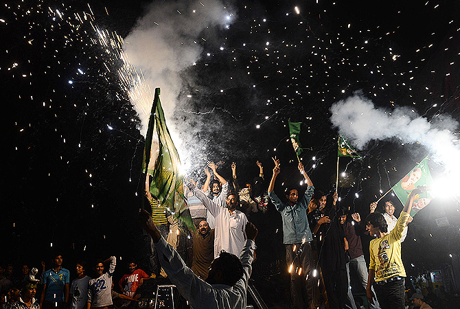 Supporters of former Pakistani Prime Minister and head of the Pakistan Muslim League-N (PML-N), Nawaz Sharif, celebrate with fireworks the victory of their party a day after landmark general elections, in Lahore, on May 12, 2013. — AFP Photo