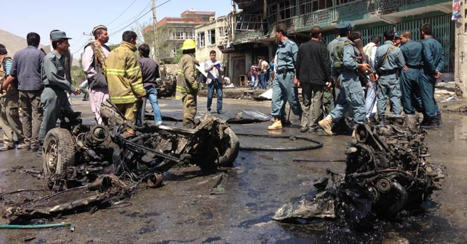 Afghan security and firefighters gather at the scene of an explosion in Kabul on May 16, 2013.  A suicide car bomb targeting foreign military vehicles exploded in the Afghan capital Kabul shortly after 8:00 am (0330 GMT), police said, confirming there were casualties. - AFP Photo