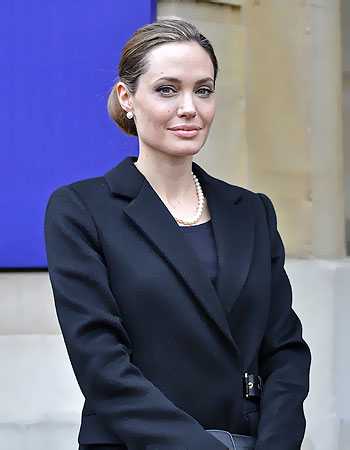 Angelina Jolie poses for a photograph as she arrives for the G8 Foreign Ministers Meeting in central London.–Reuters Photo