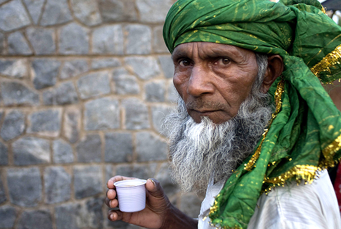 A Sufi pilgrim drinks tea near a Sufi shrine as pilgrims' transit through the city on their way to the annual Urs in Ajmer, in New Delhi. — AFP Photo