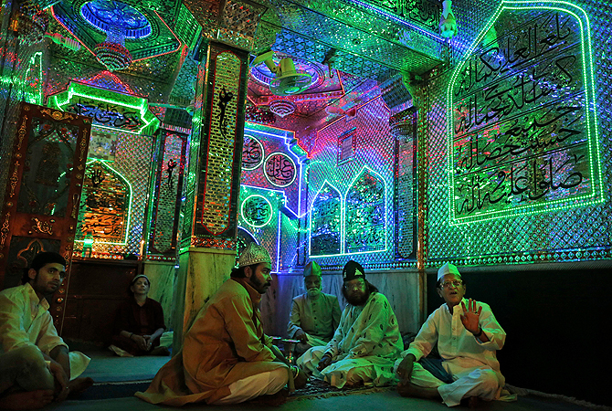 Indian Muslim Sufi devotees offer prayers at the shrine of Khwaja Moinuddin Chishti during the Urs festival in Ajmer, India. — AP Photo