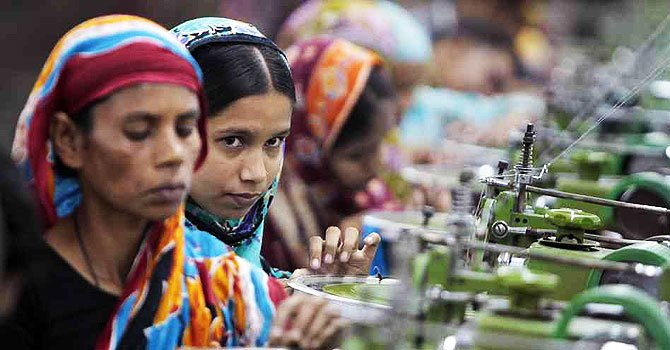 This file photo shows Bangladeshi factory workers at work. - File Photo