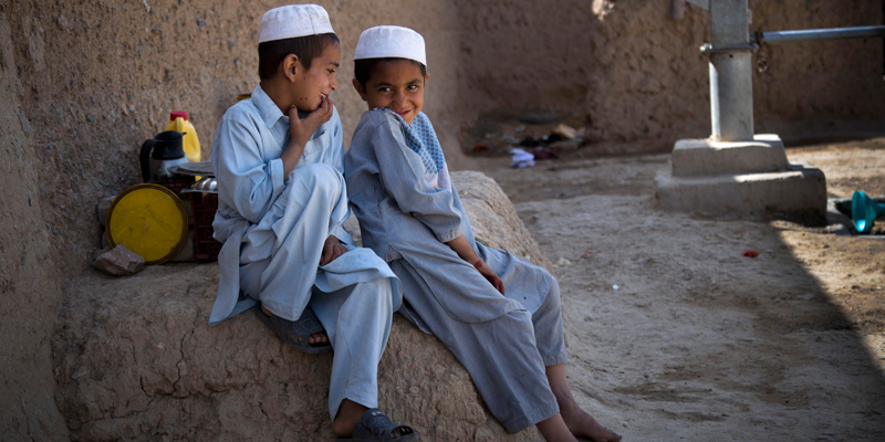Masooma's son's Naseebullah, left, and Azatullah sit together in the outskirts of Kandahar, Afghanistan on Saturday, April 20, 2013. In an interview, their mother recounted the events of pre-dawn March 11, 2012 when she says a U.S. soldier rampaged through two villages killing 16 people, including their father.  — AP Photo.