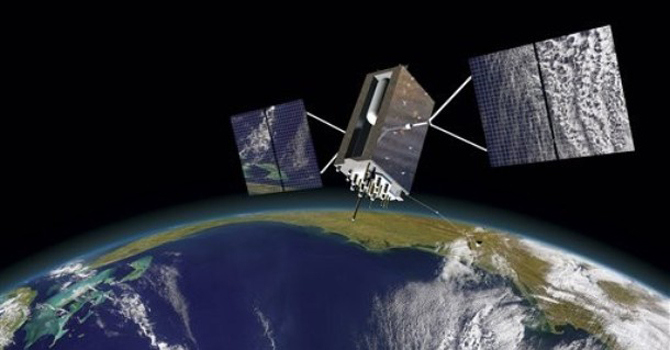 This file photo shows a GPS satellite orbiting the Earth. - File Photo