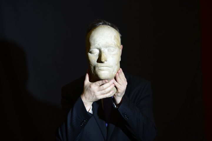 A worker poses with the death mask of the French Emperor Napoleon Bonaparte, at Bonhams auction house in London May 17, 2013.