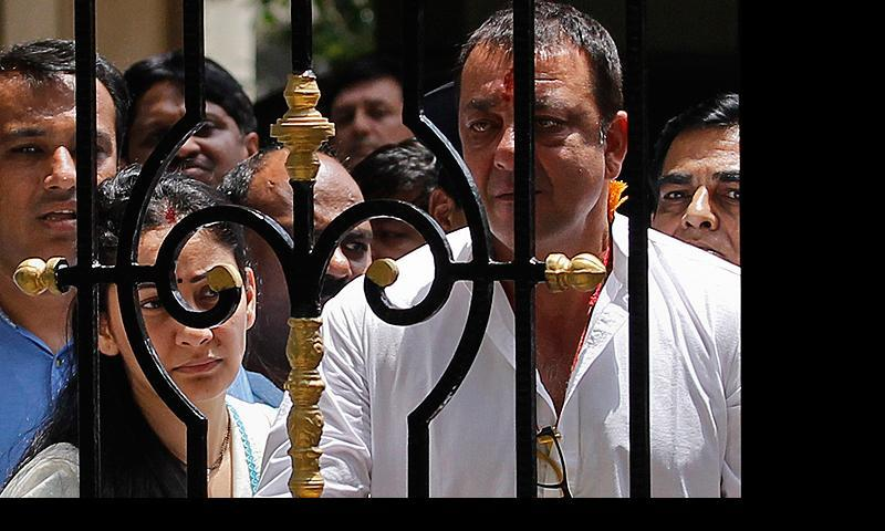 Bollywood actor Sanjay Dutt looks out from his house as he leaves to surrender at a court, in Mumbai May 16, 2013. Actor Sanjay Dutt is set to go to prison today after India's Supreme Court last week rejected a petition seeking a review of his earlier jail sentence for firearms offences during the Mumbai blasts 20 years ago. — Reuters Photo