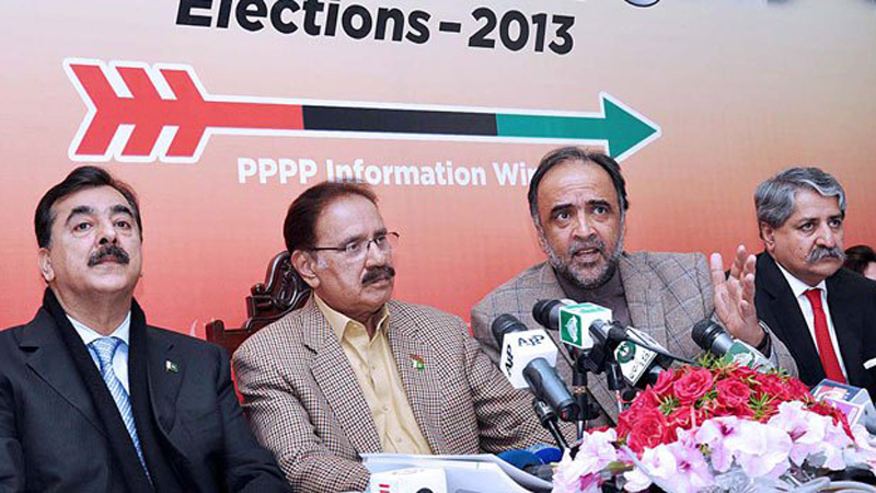 Federal Minister for Information & Broadcasting, Qamar Zaman Kaira, former premier Yousaf Raza Gilani, party leaders Makhdoom Amin Fahim and Naveed Qamar presenting the manifesto for election 2013 during a press conference at PPP Secretariat. — Photo by APP