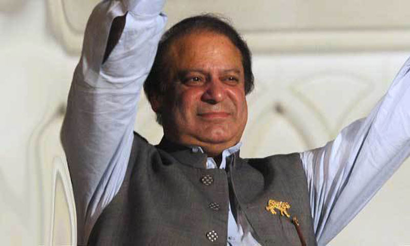 Former prime minister and leader of the Pakistan Muslim League-N (PML-N) Nawaz Sharif waves to supporters after his party victory in general election in Lahore on May 11, 2013.— File Photo by AFP