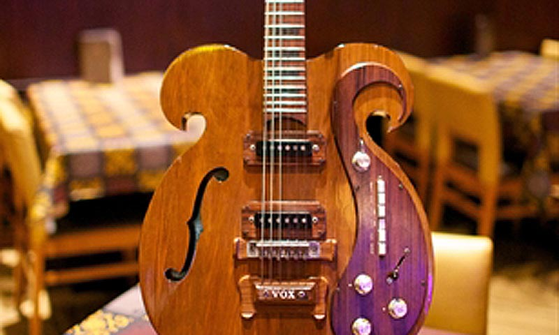 A custom-made electric guitar played by the late John Lennon and George Harrison of the Beatles. — Courtesy Photo